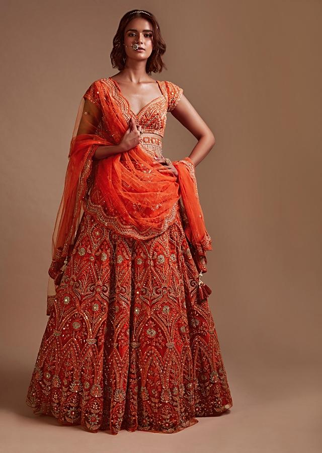 Coral Orange Lehenga Choli In Net With Mirror And Sequins Embroidered Floral And Mughal Embroidery Along With Belt Detailing Online - Kalki Fashion