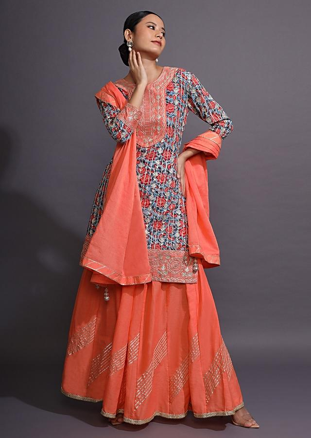 Coral Peach Sharara Suit With Blue Floral Printed Kurti And Gotta Pati Work Online - Kalki Fashion