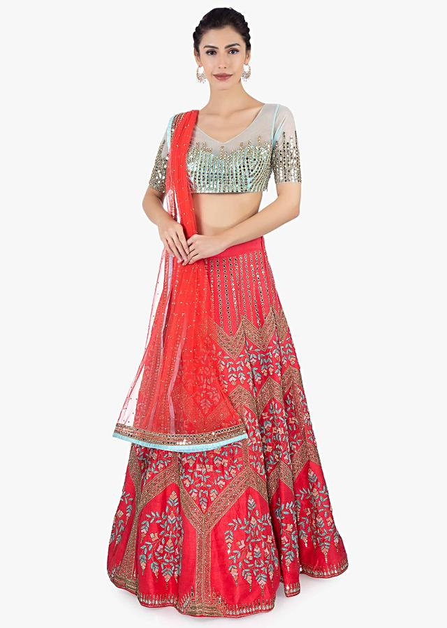 Coral Lehehnga In Raw Silk With Heavy Embroidery Paired With Contrasting Mint Green Blouse And Matching Net Dupatta Online - Kalki Fashion