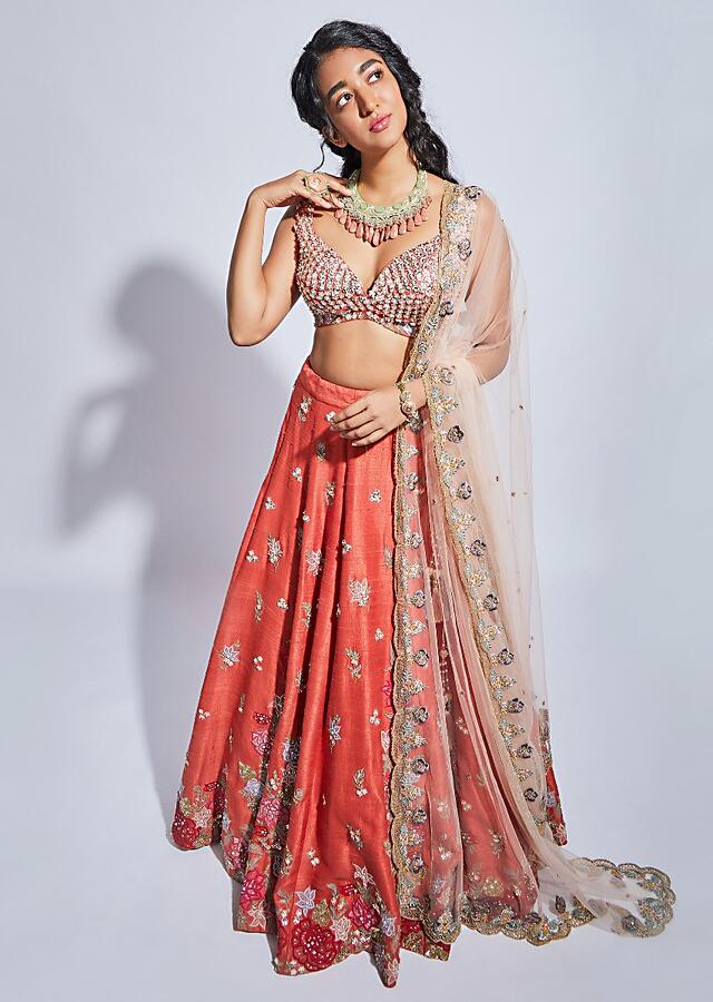 Coral Lehenga Choli With Resham Embroidered Summer Blossoms Along The Hemline And Scattered Buttis Online - Kalki Fashion