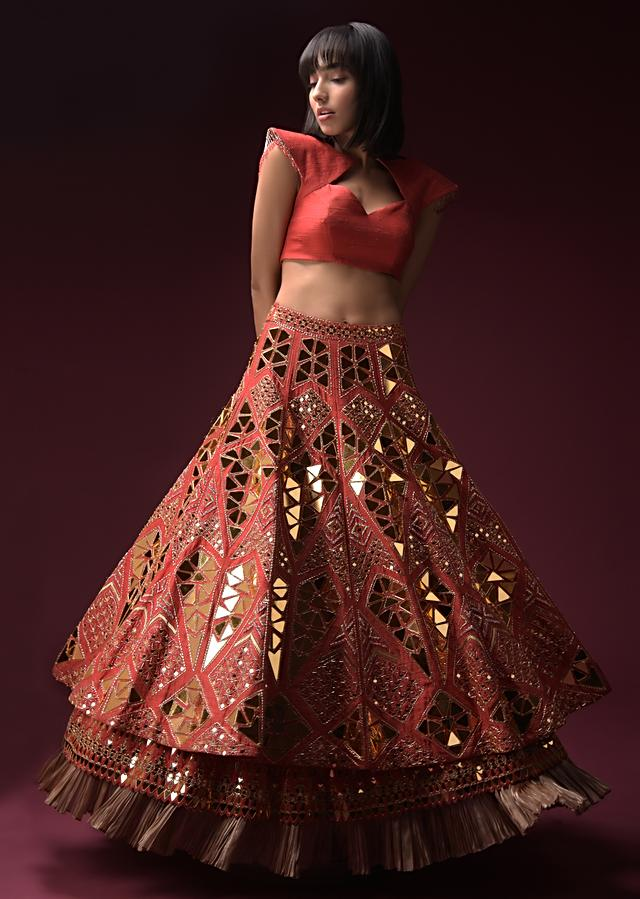 Coral Lehenga With Hand Embroidered Geometric Mirror Work And Plain Raw Silk Choli With Tassels On The Sleeves Online - Kalki Fashion