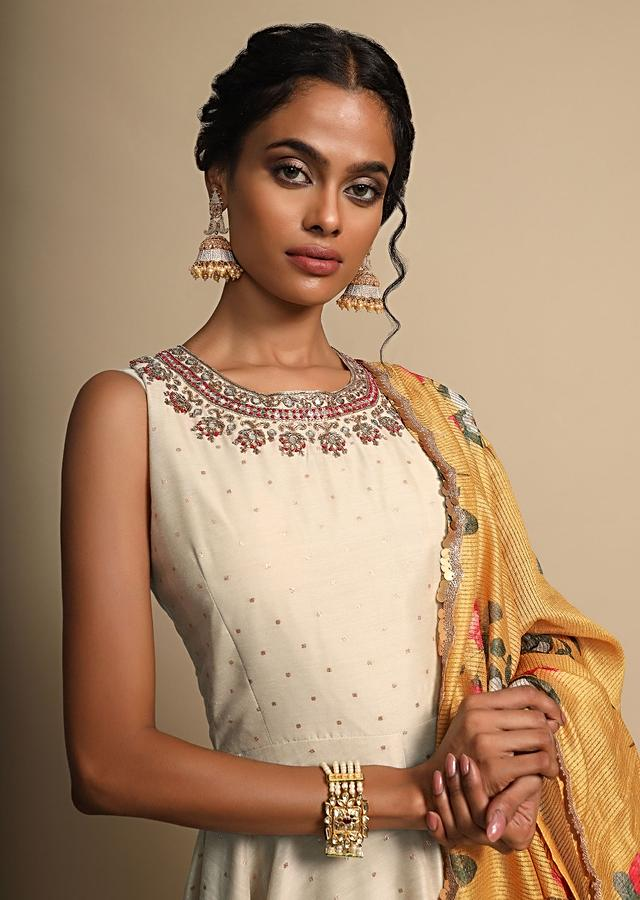 Cream Anarkali Suit With Zardozi Embroidered Neckline And A Yellow Floral Printed Dupatta Online - Kalki Fashion