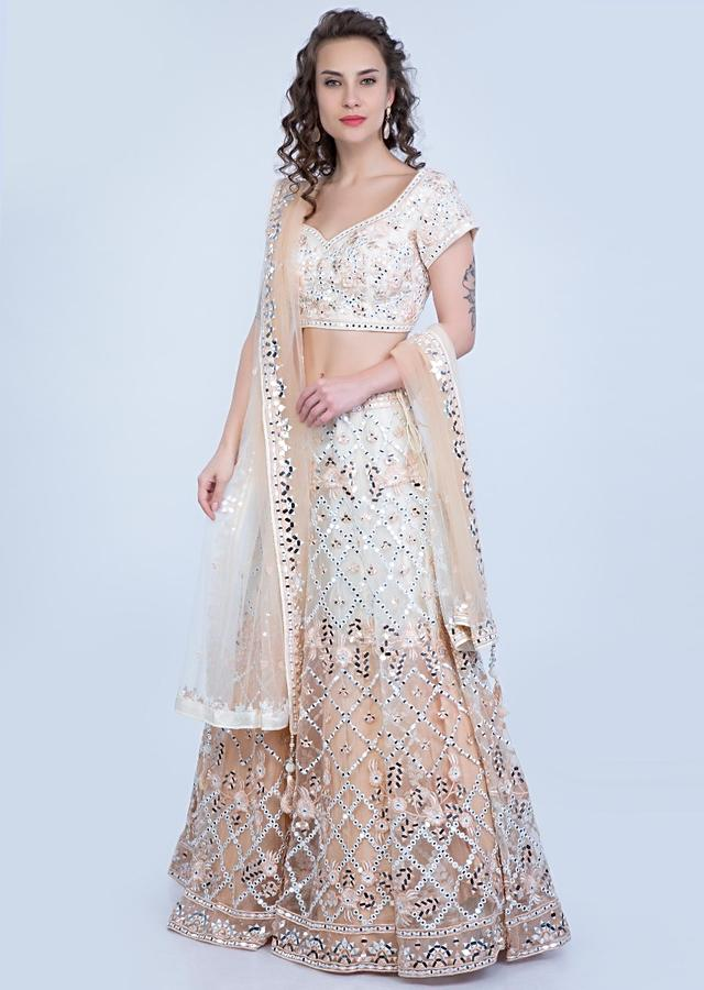 Cream And Beige Lehenga In Shaded Net With Mirror Jaal Embroidery Online - Kalki Fashion
