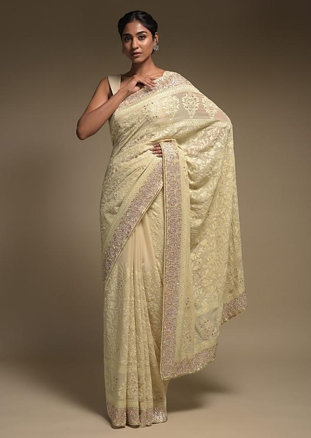 Cream Beige Saree In Georgette Adorned With Lucknowi Thread Embroidery In Floral Jaal Online - Kalki Fashion