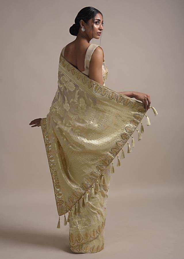 Cream Beige Saree In Georgette With Weaved Floral Jaal And Gotta Embroidered Border Online - Kalki Fashion