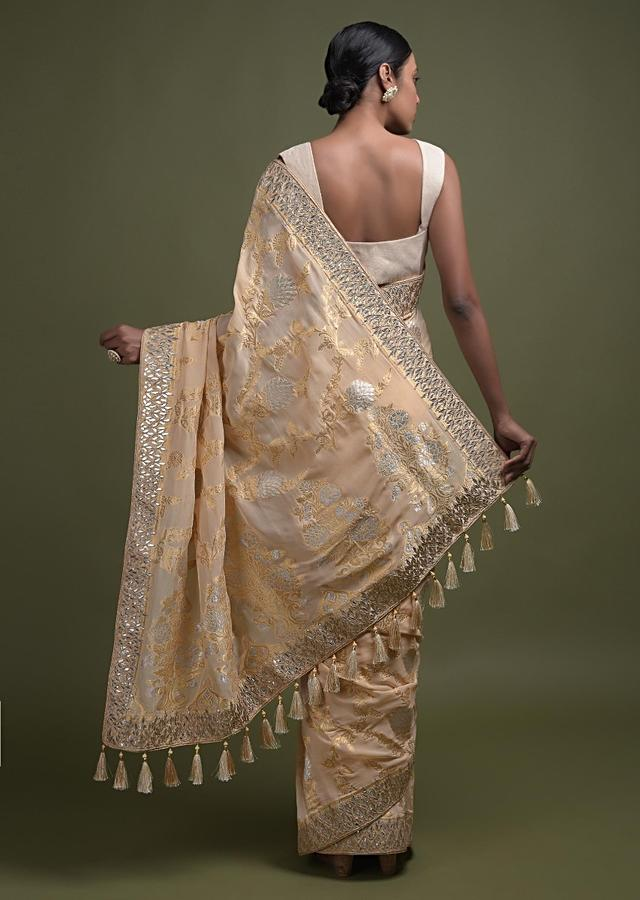 Cream Beige Saree In Georgette With Weaved Floral Pattern And Gotta Patch Embroidered Border Online - Kalki Fashion