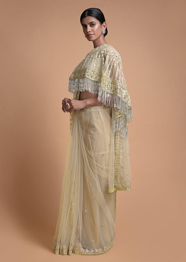 Cream Beige Saree In Net With Matching Cape Having Jaal Embroidery And Fringes Online - Kalki Fashion
