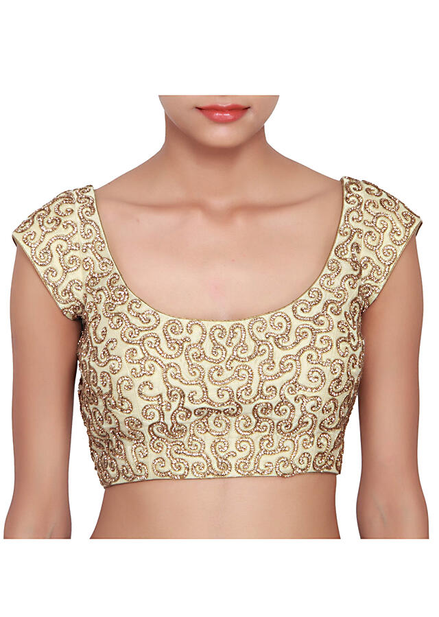 Cream blouse featured in raw silk, embelllished with gold stone work all over only on Kalki