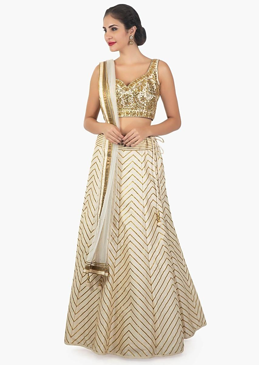 eb636dde4d Cream chanderi silk lehenga set embellished in gota lace and mirror work  only on Kalki