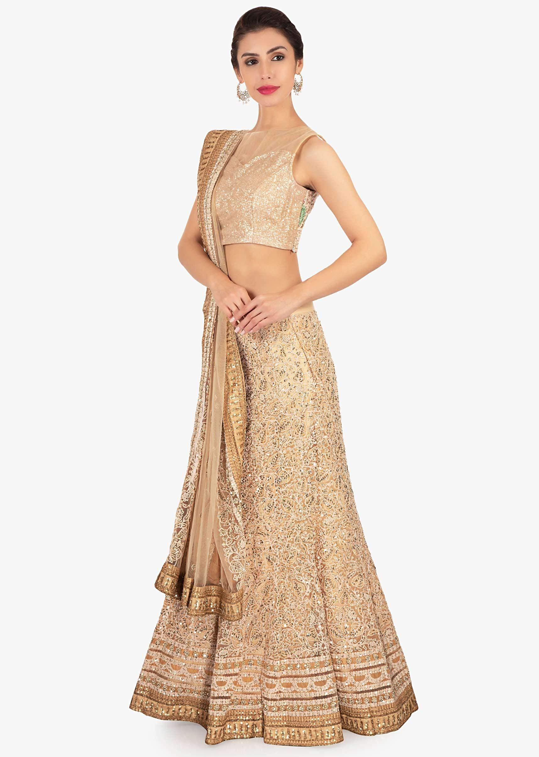 78234e63c6c3c Cream net lehenga paired with sequin fabric blouse and matching net dupatta  only on KalkiMore Detail