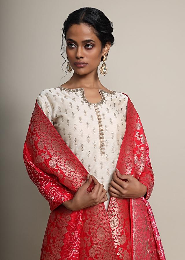 Cream Palazzo Suit With Sequins Buttis And Red Bandhani Printed Dupatta Online - Kalki Fashion