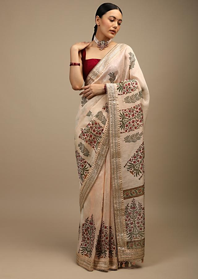 Cream Peach Saree In Tussar Silk With Printed Floral And Botanical Motifs And Gotta Patti Embroidered Border Online - Kalki Fashion