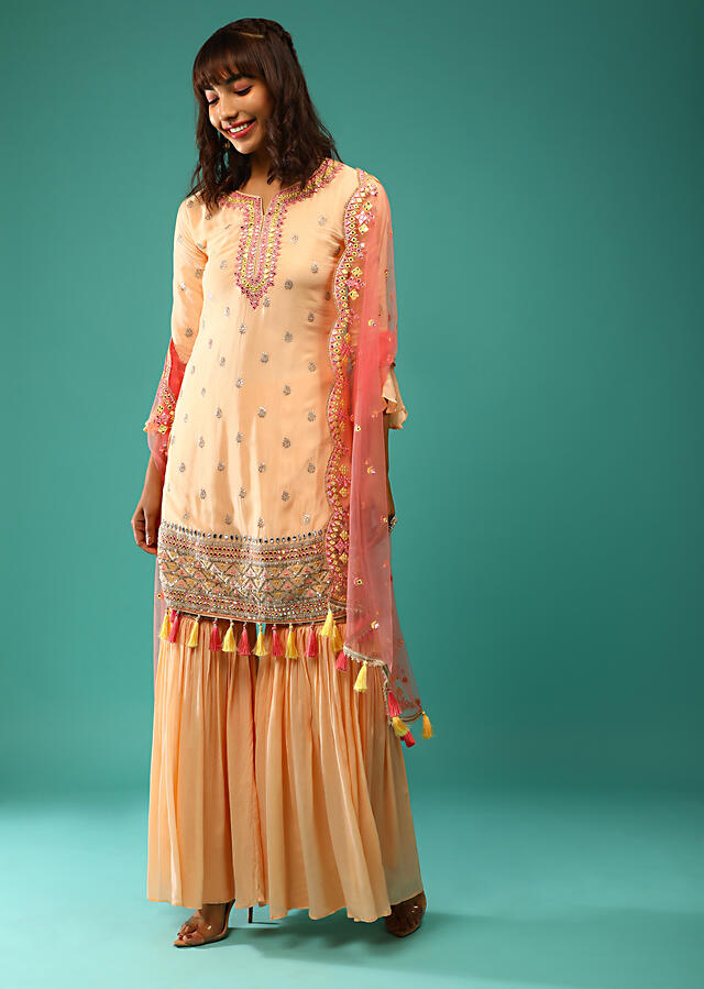 Cream Peach Sharara Suit In Crepe With Sequins Embroidered Buttis And Multi Colored Mirror Abla And Tassel Details Online - Kalki Fashion