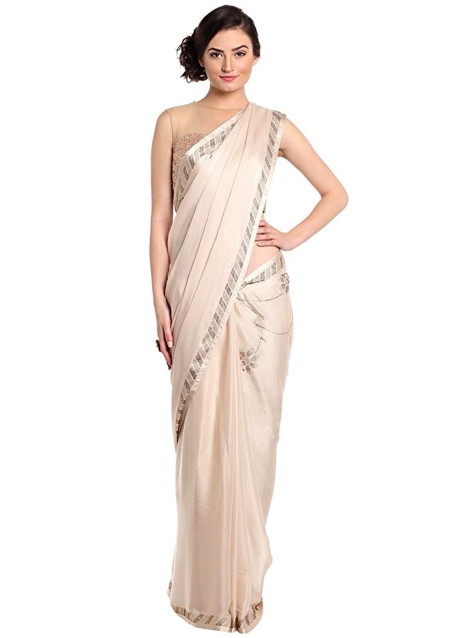 Cream Saree With Kundan Work In Floral Motif Online - Kalki Fashion