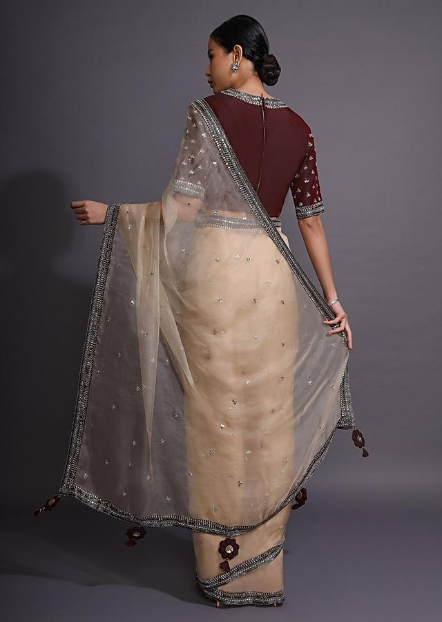 Cream Saree In Organza With Mirror Embellished Buttis And Contrasting Maroon Border Online - Kalki Fashion