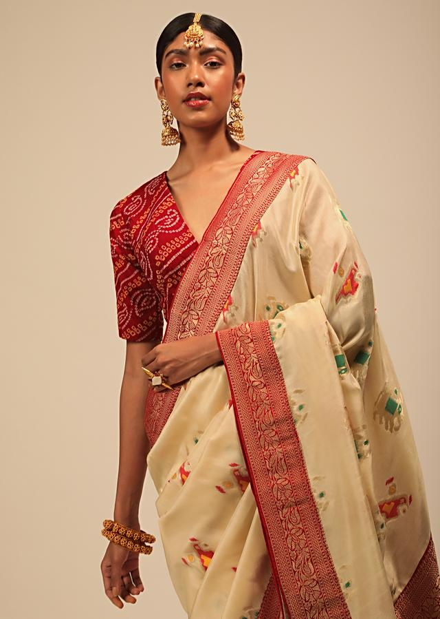 Cream Saree In Silk With Elephant And Bird Motifs And Red Brocade Bandhani Pallu And Border Along With Unstitched Blouse Online - Kalki Fashion