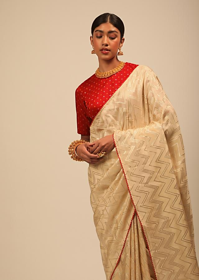 Cream Saree In Silk With Lurex Woven Chevron Design And Thin Border Along With Unstitched Blouse Online - Kalki Fashion