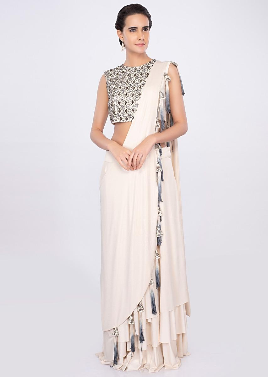 ceed44bc632 Cream shimmer lycra skirt with matching blouse and prestitched dupatta only  on kalki