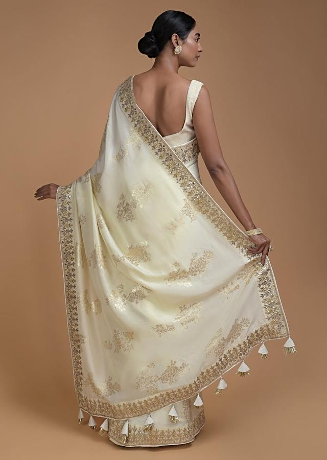 Cream White Saree In Silk With Weaved Floral Motifs In Repeat Pattern Online - Kalki Fashion