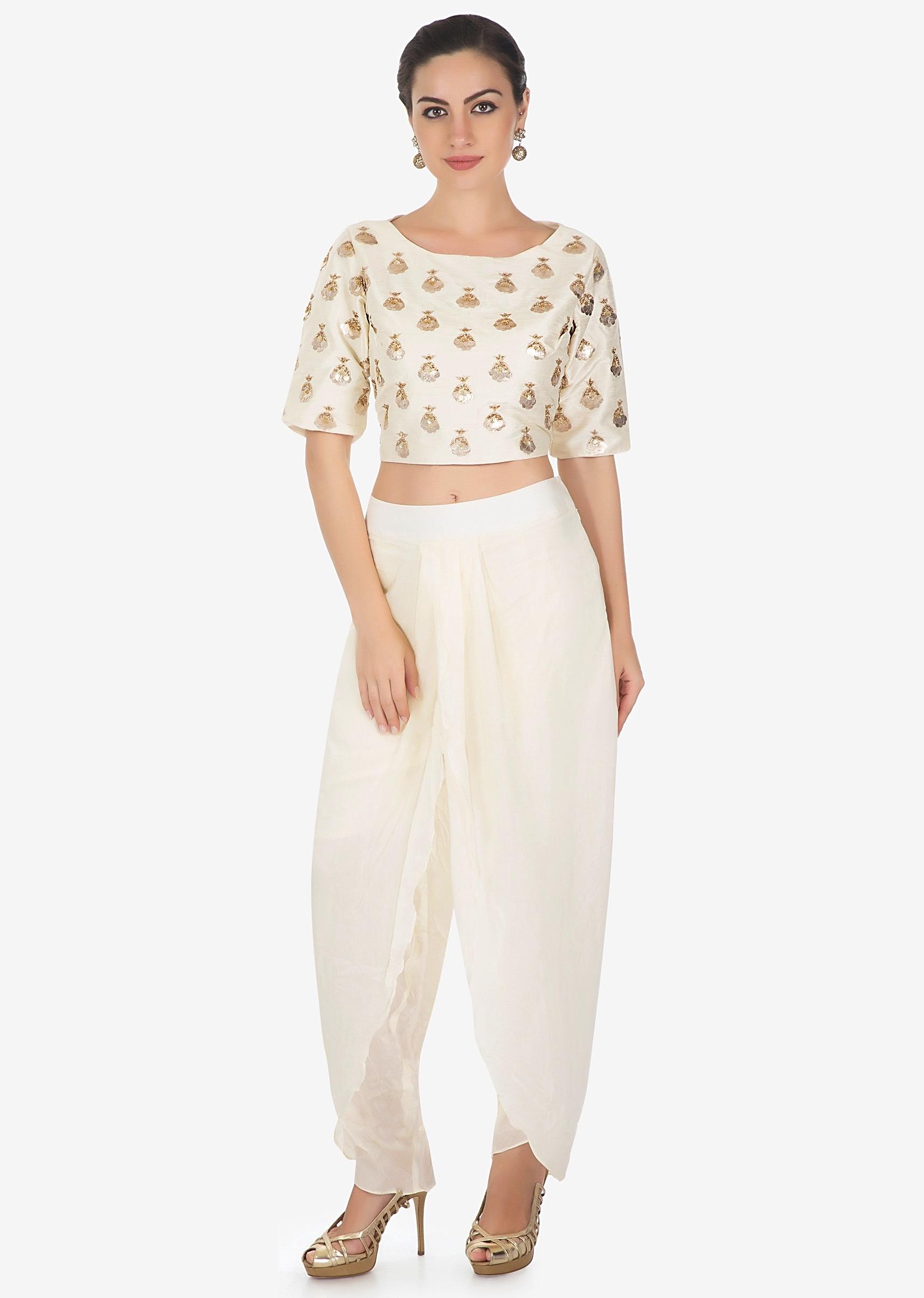 c908cb1bc5e78 Cream dhoti pants matched with crop top blouse in gotta patch butti only on  KalkiMore Detail