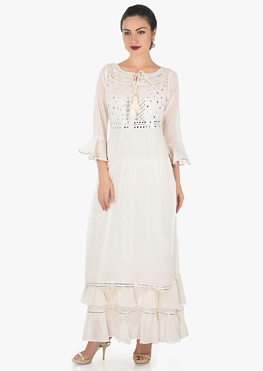 ebb00e61cf Cream double layer dress embellished in mirror and resham embroidery only  on Kalki