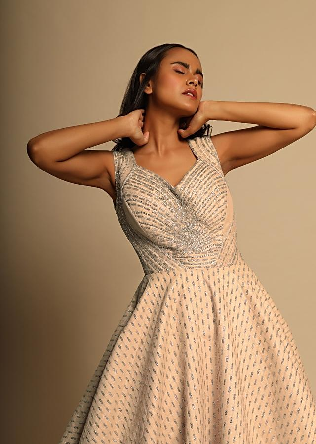 Cream fancy shimmer gown in sequins butti with deep v from back Online - Kalki Fashion
