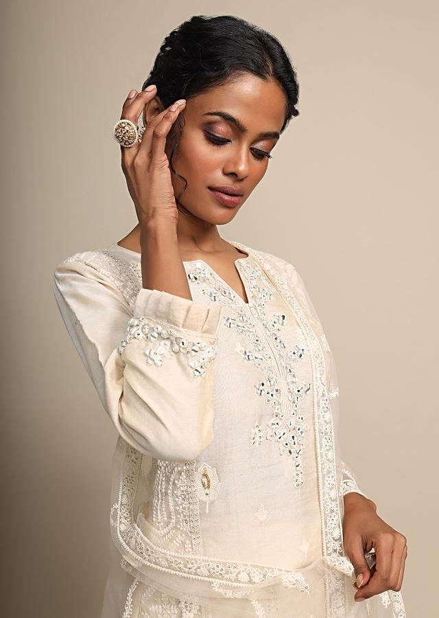 Cream Palazzo Suit With Thread Embroidered Buttis And Mirror Work On The Neckline Online - Kalki Fashion