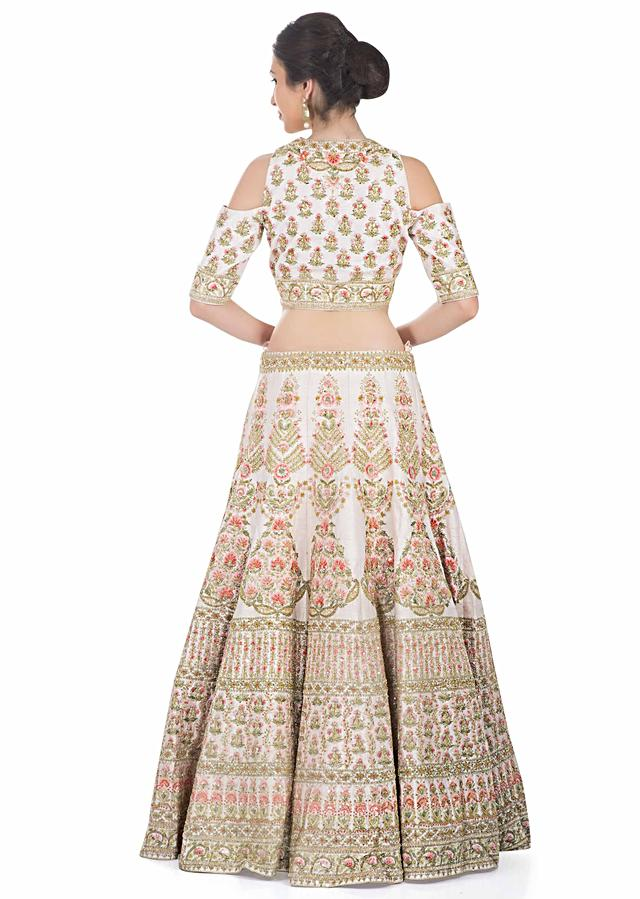 Cream pink lehenga with cold shoulder blouse in resham embroidery only on Kalki