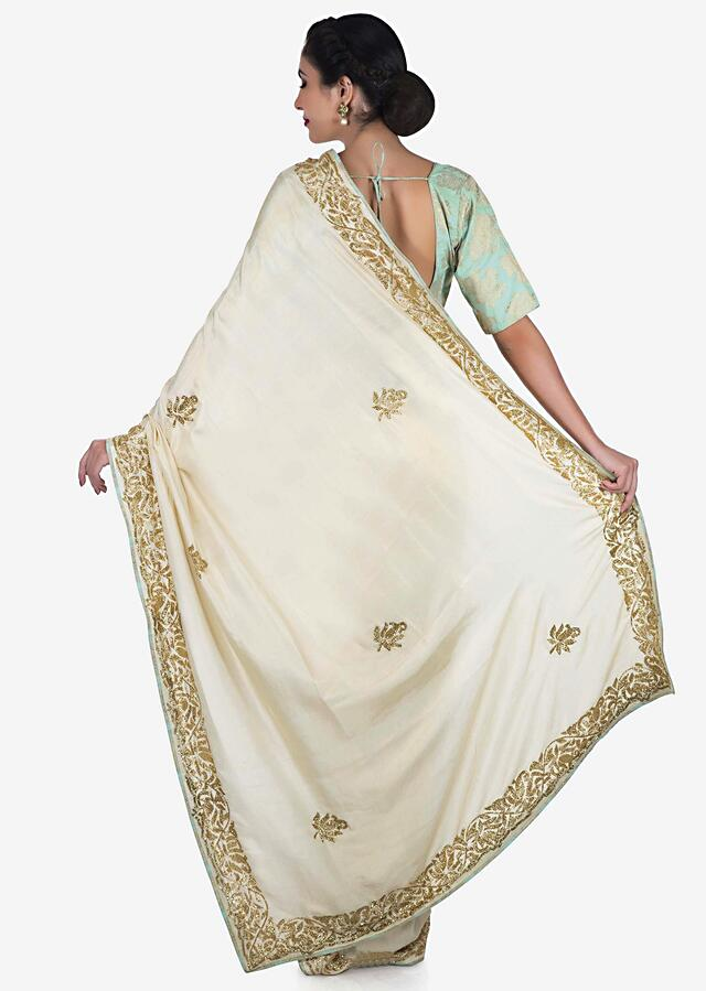 Cream Saree In Satin Silk With A Brocade Blouse Adorned In Cut Dana Work Online - Kalki Fashion