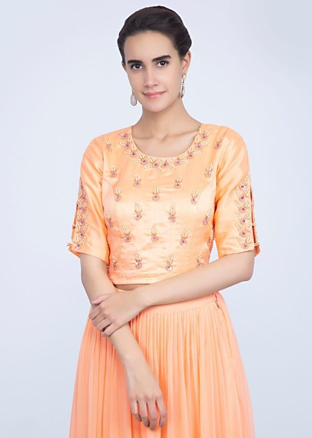Creamish Peach Blouse With Embroidery Work Paired With Shaded Lehenga Online - Kalki Fashion