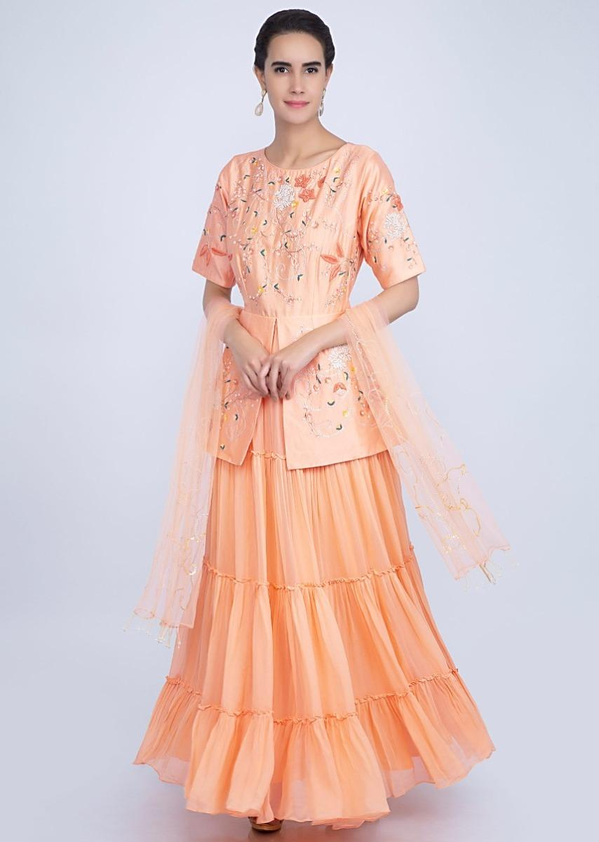 74f29459ef Creamish peach fancy suit with peplum style embroidered bodice only on Kalki More Detail