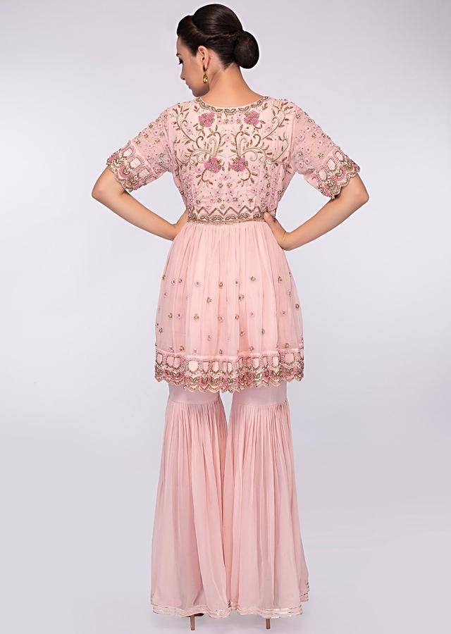 Crepe pink georgette sharara paired with matching embroidered suit only on Kalki