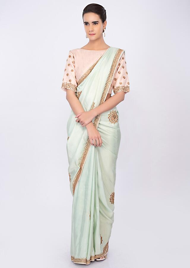 Crepe Silk Mint Green Saree With Embroidered Border And Buttis Online - Kalki Fashion
