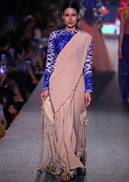 Model walks the ramp in beige saree matched with embroidered blouse for Manish Malhotra Blue Runway collection at Lakme Fashion Week Summer Resort 2015