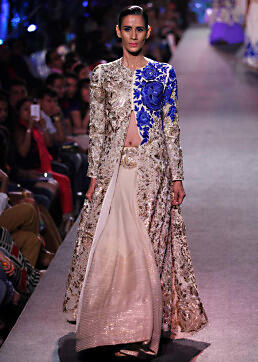 Model walks the ramp in cream lehenga with long jacket embroidered blouse for Manish Malhotra Blue Runway collection at Lakme Fashion Week Summer Resort 2015
