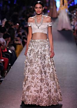 Model walks the ramp in cream lehenga with off shoulder blouse for Manish Malhotra Blue Runway collection at Lakme Fashion Week Summer Resort 2015