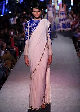 Model walks the ramp in cream saree with full sleeve embroidered blouse for Manish Malhotra Blue Runway collection at Lakme Fashion Week Summer Resort 2015
