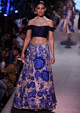 Model walks the ramp in gold and sequin embellished lehenga with off shoulder blouse for Manish Malhotra Blue Runway collection at Lakme Fashion Week Summer Resort 2015