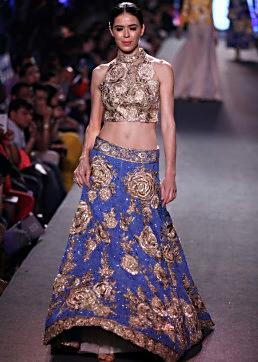 Model walks the ramp in lehenga with gold blouse in halter neckline for Manish Malhotra Blue Runway collection at Lakme Fashion Week Summer Resort 2015