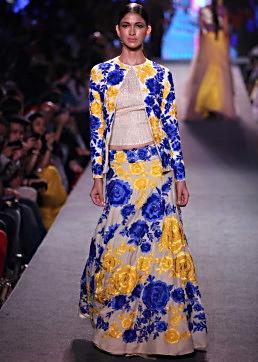 Model walks the ramp in light purple gown adorn in zari embroidery for Manish Malhotra Blue Runway collection at Lakme Fashion Week Summer Resort 2015