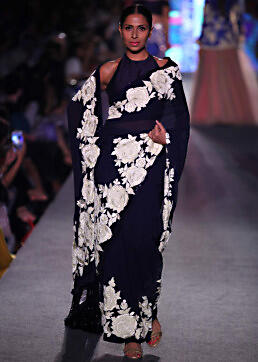 Model walks the ramp in navy blue saree with rose motif embroidered border for Manish Malhotra Blue Runway collection at Lakme Fashion Week Summer Resort 2015
