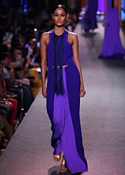 Model walks the ramp in purple embroidered jacket suit for Manish Malhotra Blue Runway collection at Lakme Fashion Week Summer Resort 2015