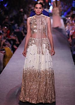 Model walks the ramp in white and gold lehenga adorn in sequin for Manish Malhotra Blue Runway collection at Lakme Fashion Week Summer Resort 2015