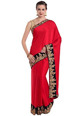 Coral red satin silk saree with zari work and french knot border