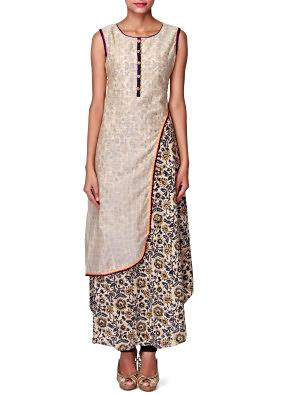 Cream kurti with fancy side slit and printed under layer