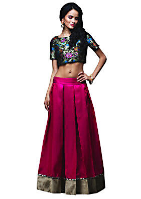 Deep pink skirt matched with crop top brocade blouse only on Kalki