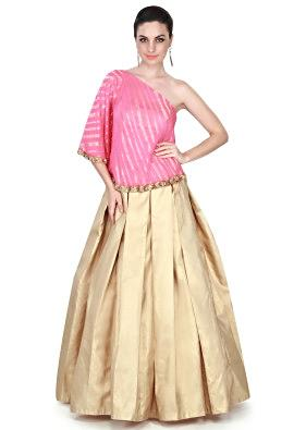 Gold lehenga matched with pink cape