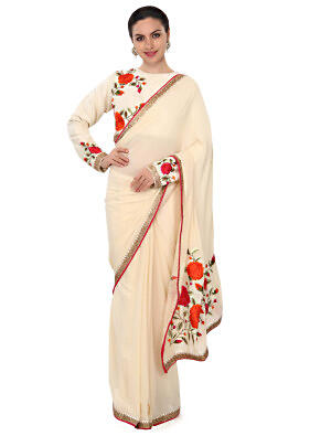 Curry cream saree enhanced in resham in floral motif only on Kalki