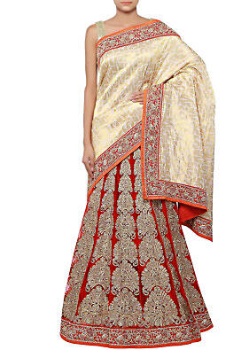 Half and half lehenga saree in dusky cream and red enhanced in zari embroidery only on Kalki