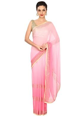 Pink shaded saree adorn in kundan embroidered border only on Kalki
